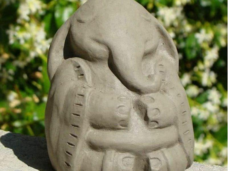 stone elephant meditating
